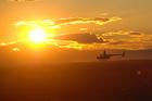 ヘリコプターでシドニーの夕暮れの景色を上空から楽しむ